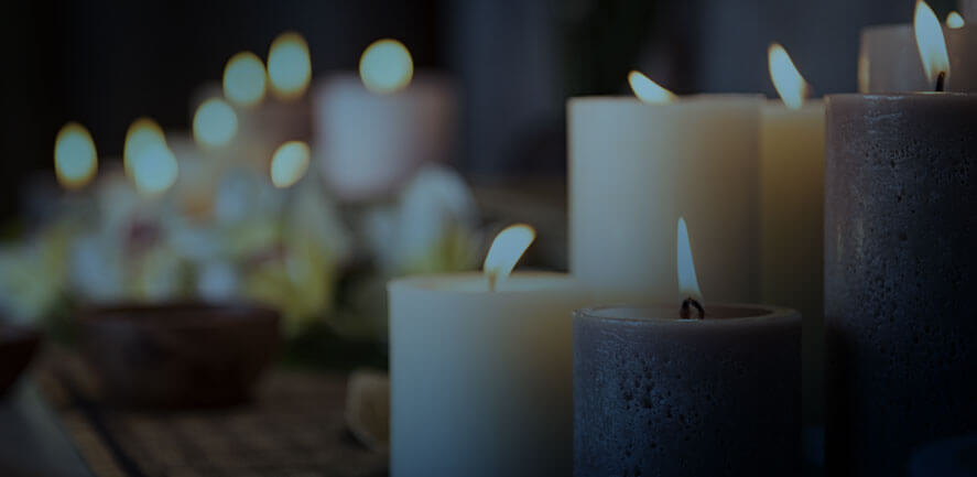 vigil candles of different sizes lit with flame | Wisconsin wrongful death attorney